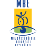 M.B.E.