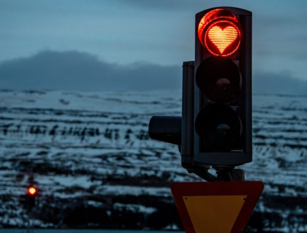 image showing a traffic red light with the shape of a red heart