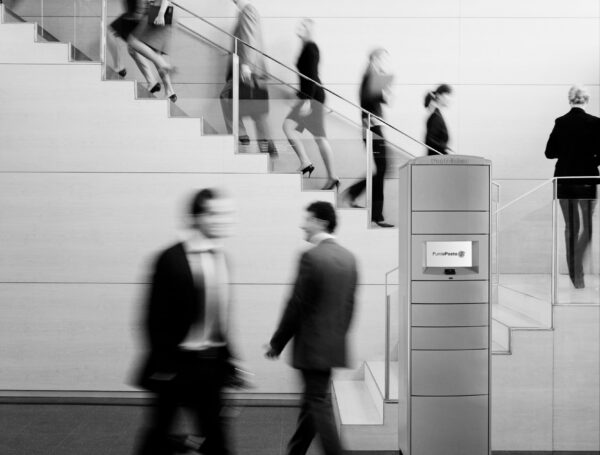 Business people walking on busy office staircase